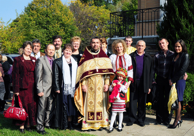 Reverend Father Volodymyr Feskiv with members of his family — Ukrainian Orthodox Church of St. Anne, Toronto (Scarborough), Ontario.